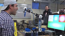 Northeastern University students develop eye controlled robotic arm that's happy to feed you