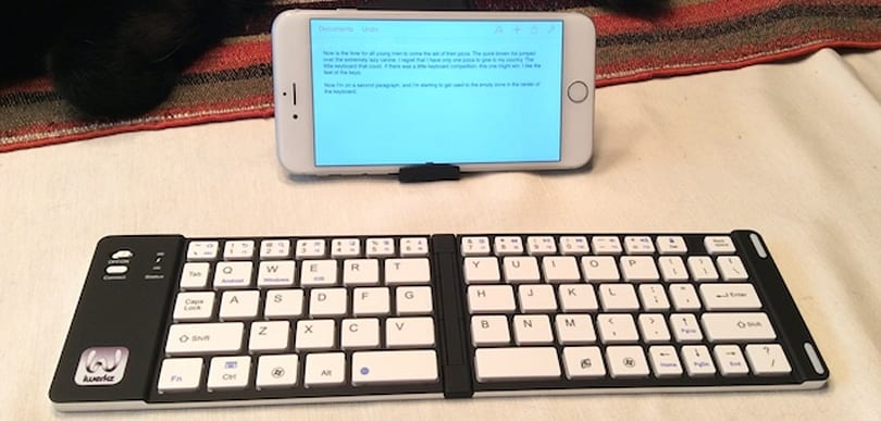 iPhone 6 Plus + cheap folding Bluetooth keyboard = little laptop