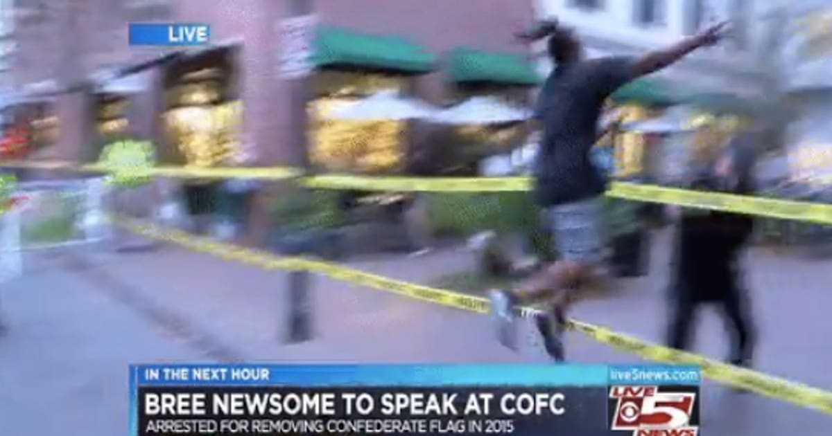 Man Leaps Over Barricade To Snatch Confederate Flag On Live TV