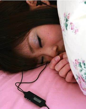 Earbud / alarm clock takes the comfort out of sleeping