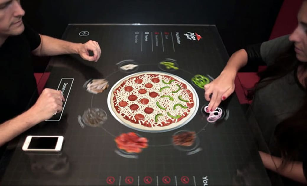 Pizza hut 39 s concept touch table lets you swipe your way to for Table 5 pizza