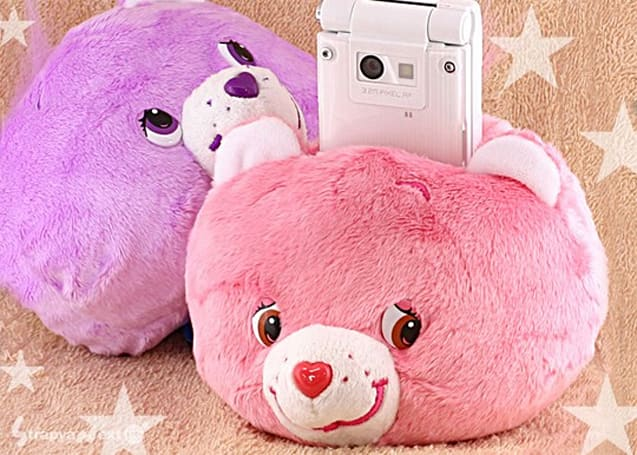 Stuffed Care Bears head is a perfect phone holster, complete nightmare