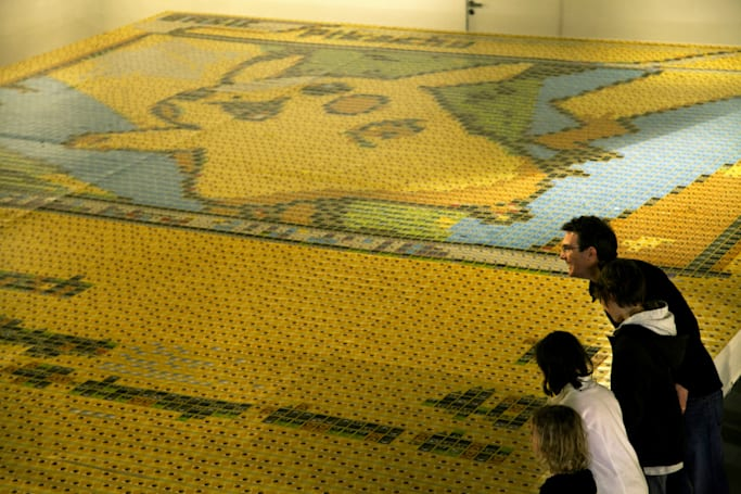 The world's largest Pokemon card is actually 13,000 cards in one