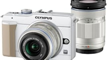 Olympus E-PL1S is a slightly improved PEN, world's lightest with interchangeable lenses