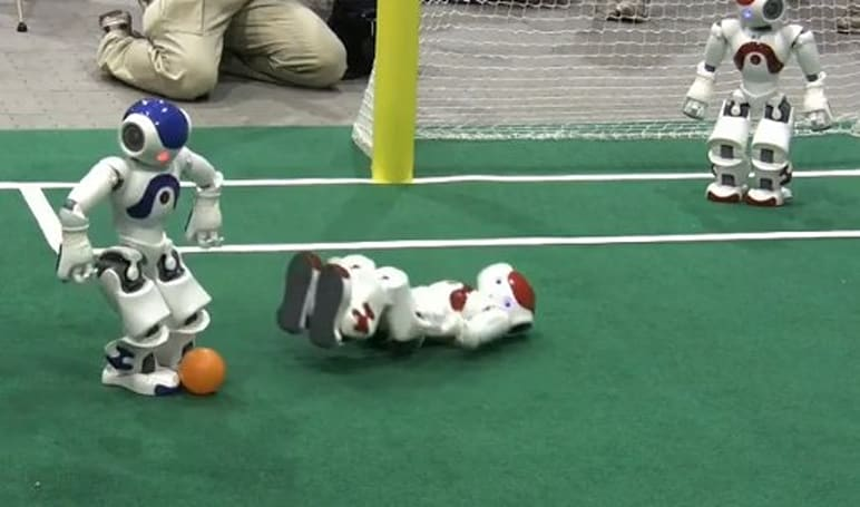 RoboCup bots experiment with our preconceived notions of competition, standing up