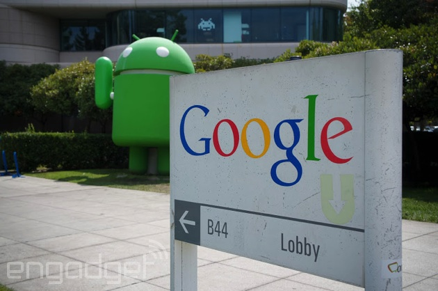 Google campus sign with Android looming in the background