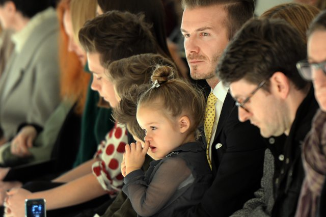 Harper Beckham on David's knee at New York Fashion Week