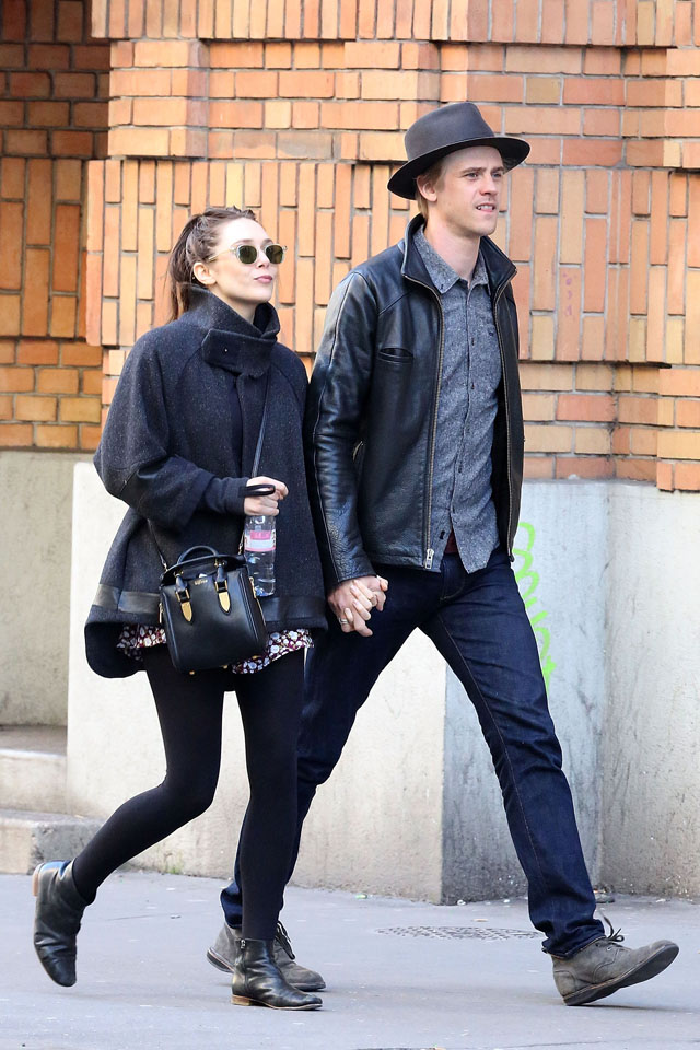PARIS, FRANCE - MARCH 06:  Actress Elizabeth Olsen and her boyfriend Boyd Holbrook are seen strolling on March 6, 2014 in Paris, France.  (Photo by Marc Piasecki/GC Images)
