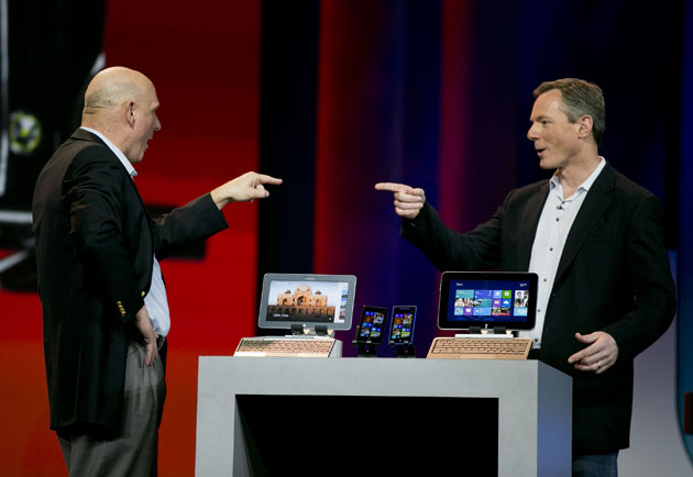 Paul Jacobs, chief executive officer of Qualcomm Inc., right, and Steve Ballmer, chief executive officer of Microsoft Corp., gesture towards each other during a keynote speech at the 2013 Consumer Electronics Show in Las Vegas, Nevada, U.S., on Monday, Jan. 7, 2013. The 2013 CES trade show, which runs until Jan. 11, is the world's largest annual innovation event that offers an array of entrepreneur focused exhibits, events and conference sessions for technology entrepreneurs. Photographer: Andrew Harrer/Bloomberg via Getty Images