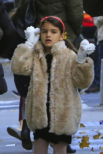 109019, NEW YORK, NEW YORK - Wednesday November 20, 2013. Suri Cruise seen wearing what appears to be a fur coat as she arrives at school with her nanny and bodyguard in New York City. Photograph: © PacificCoastNews **FEE MUST BE AGREED PRIOR TO USAGE** **E-TABLET/IPAD & MOBILE PHONE APP PUBLISHING REQUIRES ADDITIONAL FEES** LOS ANGELES OFFICE: +1 310 822 0419 LONDON OFFICE: +44 20 8090 4079