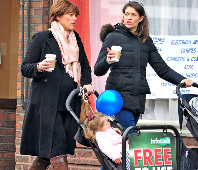 Mum-to-be Kate Silverton strolls in sunshine with daughter Clemency