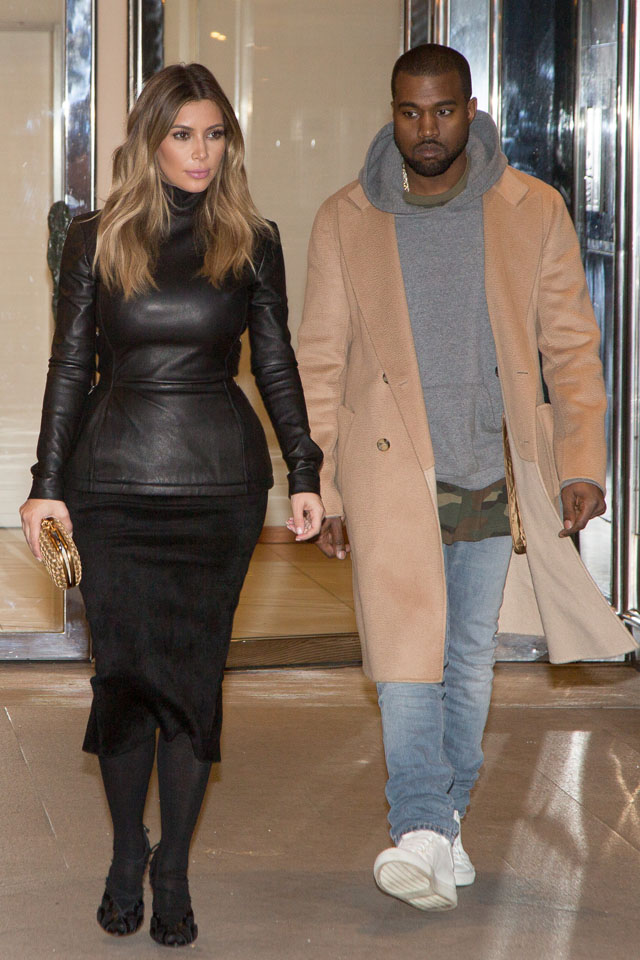 PARIS, FRANCE - JANUARY 19:  Kim Kardashian and Kanye West are seen on January 19, 2014 in Paris, France.  (Photo by Marc Piasecki/Getty Images)