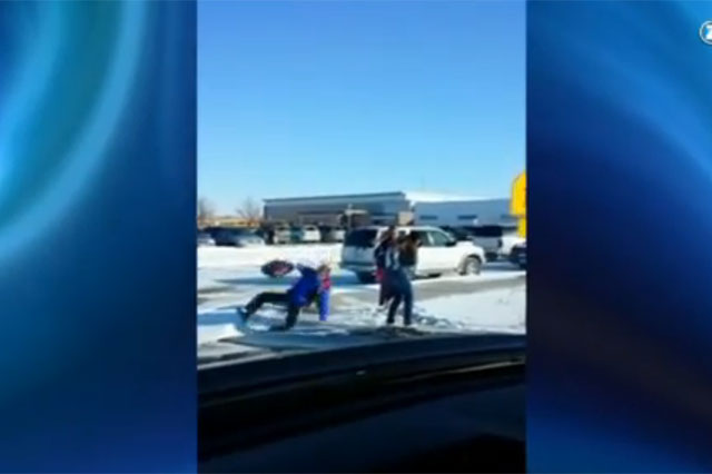 dad films kids slipping over on ice