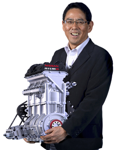 NISMO President Shoichi Miyatani holding the 88-pound/400-horsepower 1.5-liter three-cylinder race engine
