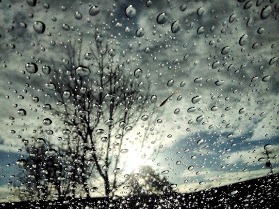 Raindrops appear on a windshield following the first rain of the year, early Thursday, Jan. 30, 2014, in Novato, Calif. Northern California is finally getting rain after some areas have gone without measurable moisture for weeks. But the precipitation won't help much to ease the drought that has plagued the region. (AP Photo/Marin Independent Journal, Robert Tong)