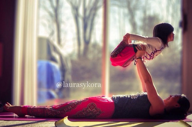 Laura Kasperzak and her four year old daughter practice yoga