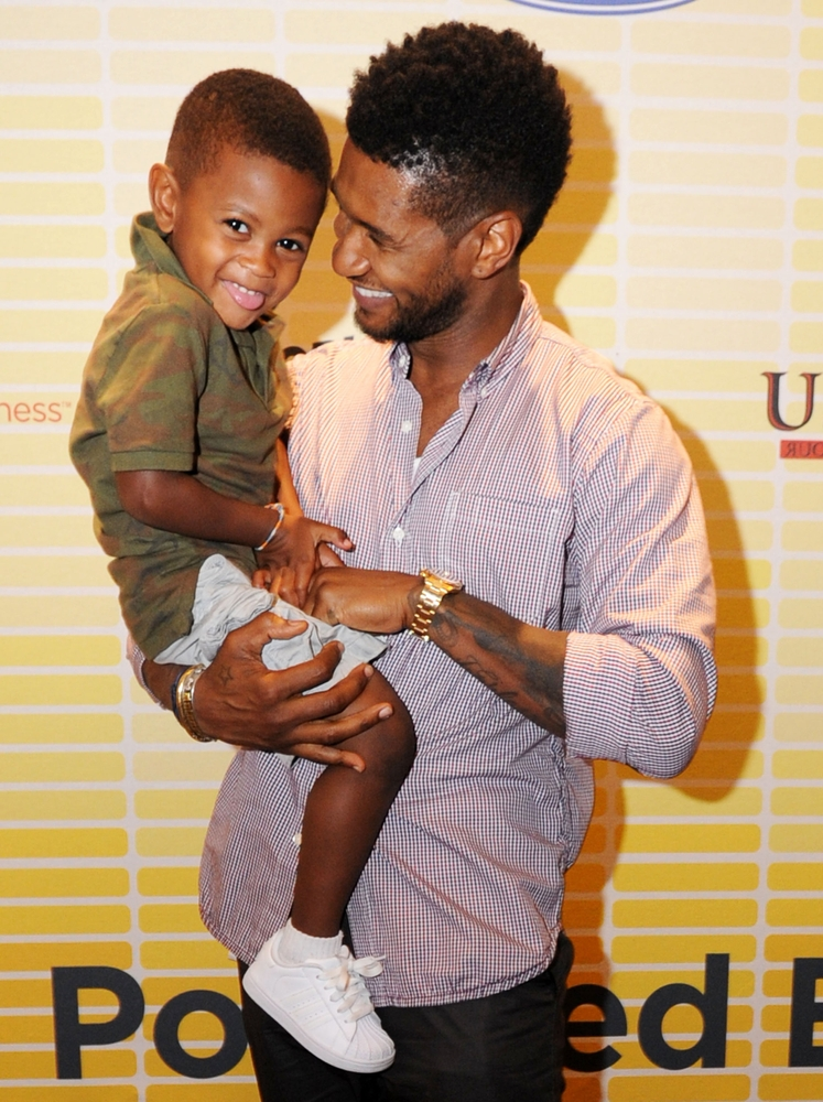 ATLANTA, GA - JULY 21:  Usher (R) and his son, Usher Raymond V, attend Usher's New Look Foundation - World Leadership Conference & Awards 2011 - Day 2 at Cobb Galleria on July 21, 2011 in Atlanta, Georgia.  (Photo by Chris McKay/Getty Images for Usher's New Look Foundation)