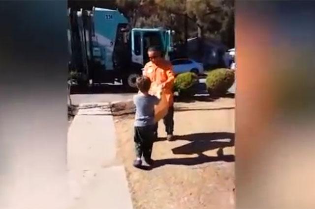autistic boy, garbage truck