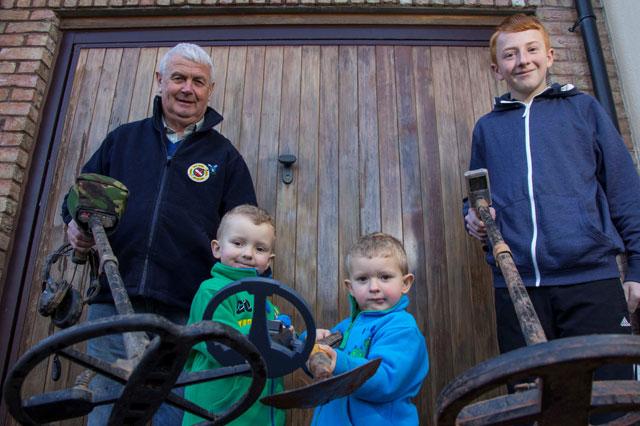 Grandfather John Hill with his grandchildren