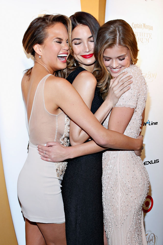 NEW YORK, NY - FEBRUARY 18:  Models Chrissy Tiegen, Lily Aldridge and Nina Agdal attend as Captain Morgan White Rum and Crown Royal XO raise a glass to the Sports Illustrated Swimsuit 50 Years of Swim Issue at the Sports Illustrated Swimsuit Beach House on February 18, 2014 in New York City.  (Photo by Cindy Ord/Getty Images for Captain Morgan and Crown Royal)