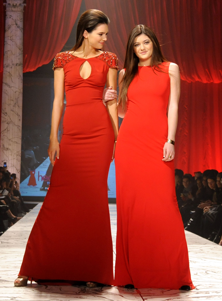 NEW YORK, NY - FEBRUARY 06:  Kendall Jenner and Kylie Jenner wearing Badgley Mischka on the runway during The Heart Truth 2013 Fashion Show held at the Hammerstein Ballroom on February 6, 2013 in New York City.  (Photo by Jennifer Graylock/Getty Images for Heart Truth)