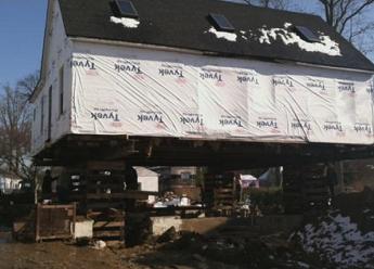 derossett house lifted above floodplain