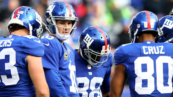 EAST RUTHERFORD, NJ - DECEMBER 15:  Eli Manning #10 of the New York Giants pauses before the huddle in the first quarter against the Seattle Seahawks at MetLife Stadium on December 15, 2013 in East Rutherford, New Jersey.  (Photo by Elsa/Getty Images)