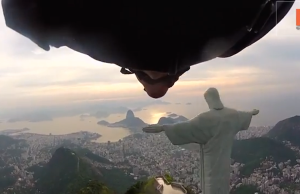 Rio de Janiero's Christ the Redeemer Statue gets buzzed by two guys in wing suits.