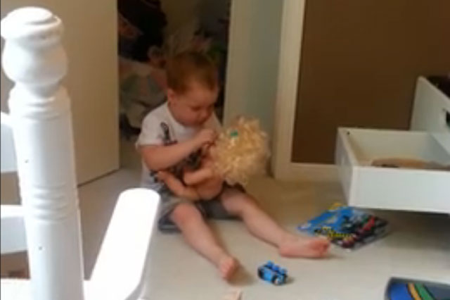 Toddler argues with talking doll