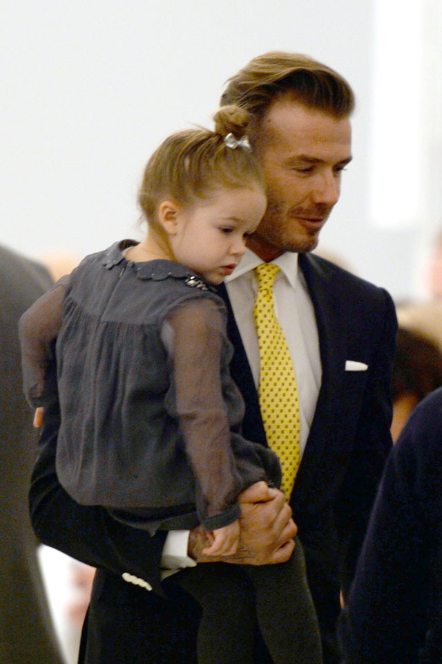 David Beckham and his daughter Harper arrive to watch the presentation of Victoria Beckham's fashions during the Mercedes-Benz Fashion Week Fall/Winter 2014 shows February 9, 2014 in New York City.  AFP PHOTO / Don EMMERT        (Photo credit should read DON EMMERT/AFP/Getty Images)