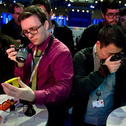 BARCELONA, SPAIN - FEBRUARY 25:  Visitors take pictures of a new Nokia device during the first day of the Mobile World Congress 2013 at the Fira Gran Via complex on February 25, 2013 in Barcelona, Spain. The annual Mobile World Congress hosts some of the world's largest communication companies, with many unveiling their latest phones and gadgets. The show runs from February 25 - February 28.  (Photo by David Ramos/Getty Images)