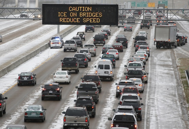 Traffic creeps along I-55 in north Jackson, Miss., Tuesday, Jan. 28, 2014 as ice and snow flurries cause difficult driving conditions. A severe winter storm is expected to hit the state bringing ice and snow to the Gulf Coast. (AP Photo/Rogelio V. Solis)