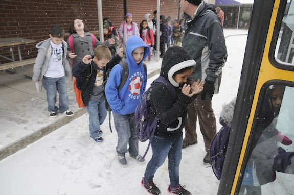 Sevierville Primary School students load up as school is let out early due to snow in Sevierville, Tenn., Tuesday, Jan. 28, 2014.  Snowfall across East Tennessee has led several school districts to call off classes early. (AP Photo/The Mountain Press, Curt Habraken)