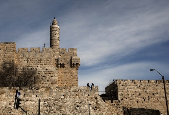 FILE - In this March 7, 2012 file photo, a couple sits next to the Tower of David on the wall surrounding Jerusalem's old city. Experts recently installed a seismic monitoring system in the Tower of David, part of Israelís initial steps to determine which ancient structures are in danger of earthquake-related collapse. (AP Photo/Sebastian Scheiner, File)
