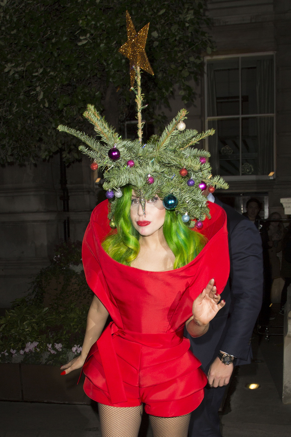 110060, LONDON, UNITED KINGDOM, Sunday December 8, 2013.Lady Garesseessed as a decorated Christmas tree is showered by an unexpected gift - a paparazzi sneaker, in London. After receiving gifts off fans outside, Lady Gaga made her way inside. During the melee to get Gaga up the stairs into the Langham Hotel, a photographer quite literally lost his footing and his left shoe flew off while being held back by security. With an inquiring look on her face, Lady Gaga helped out, picked up the offending item by pinching it with the lace, she then chuckled before putting it to one side. Gaga turned, growled theatrically and then left the scene. Photograph: ? Ringo, PacificCoastNews.com **FEE MUST BE AGREED PRIOR TO USAGE** **E-TABLET/IPAD & MOBILE PHONE APP PUBLISHING REQUIRES ADDITIONAL FEES** LOS ANGELES OFFICE: +1 310 822 0419 LONDON OFFICE: +44 20 8090 4079