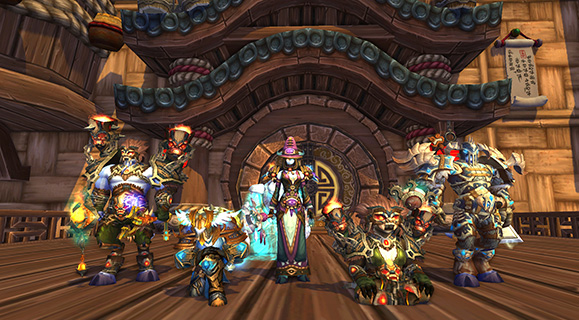 A group of characters wearing challenge mode gear, from left to right: draenei shaman, human paladin, draenei mage, pandaren shaman, draenei death knight