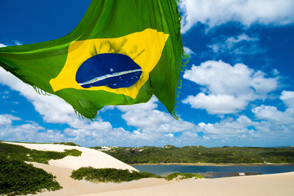 NATAL, BRAZIL - NOVEMBER 14:  View of Genipabu  lagoon with a Brazilian flag on November 14, 2013 in Natal, Brazil. The Ecological Tourist Park Dunes Genipabu includes a beach, a large complex of dunes, a lagoon and a protected area (Photo by Buda Mendes/Getty Images)