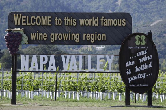 FILE - This Oct. 27, 2011, file photo shows a sign along Highway 29 welcoming visitors to the Napa Valley in Oakville, Calif. Napa Valley wine grape growers said Tuesday, Jan. 28, 2014, some vines are ripening early and that farmers are planning fewer crops to save water. (AP Photo/Eric Risberg, File)