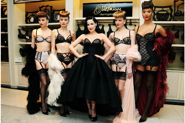 NEW YORK, NY - MARCH 20:  Dita Von Teese (C) poses with models at the Dita Von Teese Lingerie Collection Launch at Bloomingdale's 59th Street Store on March 20, 2014 in New York City.  (Photo by Desiree Navarro/Getty Images)