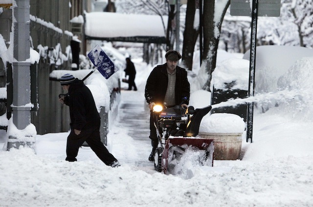 Snow shovels and a snow blower tackle the overnight accumulation on New York's Upper West Side,  Thursday, Jan. 27, 2011. (AP Photo/Richard Drew)