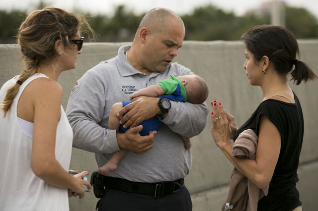 Pamela Rauseo gives her nephew the kiss of life on a Miami expressway