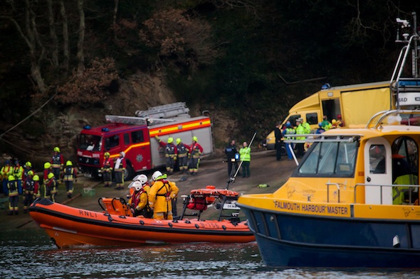 Rescue workers at the scene where a car slid into the water by the King Harry Ferry, near Truro. An inquest will today hear the details of the tragic death of Ann Pewter. See SWNS story SWFERRY: A pensioner who died after her car rolled into a river when her husband got out to take photographs was named as Ann Pewter. Tragic Ann, 74, was waiting to board the King Harry Ferry on the River Fal near Trelissick, Cornwall. It is thought her husband got out to take pictures and the car suddenly rolled forward and plunged into the freezing water. The red Mazda saloon sank and despite efforts of rescuers Ann, of Tavistock, Devon, died along with her two pet dogs.