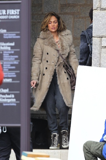 111867, ATLANTA, GEORGIA - Tuesday January 21, 2014. Jennifer Lopez dressed down and smoking a cigarette on the set of her new movie 'Lila and Eve' in Atlanta. Lopez was not her usual glamorous self, as she filmed her first scene as a distraught mother who's son has been murdered. Jlo was seen sitting outside a church smoking a cigarette, wearing sweatpants, gold hightop shoes and a beige coat and looking sad. The American Idol judge's long locks were hidden underneath a shoulder length wig. The film is based around two mothers who set out to find the culprits who murdered their children after police fail to help. Photographer: Thibault Monnier, © PacificCoastNews.com **FEE MUST BE AGREED PRIOR TO USAGE** **E-TABLET/IPAD & MOBILE PHONE APP PUBLISHING REQUIRES ADDITIONAL FEES** LOS ANGELES OFFICE: +1 310 822 0419 LONDON OFFICE: +44 20 8090 4079