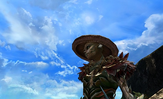 Sylvari character in front of blue sky backdrop