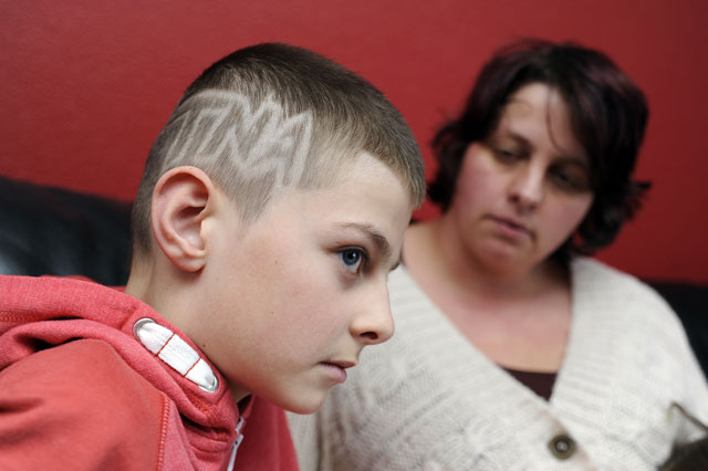 Boy with wrestling logo hair cut
