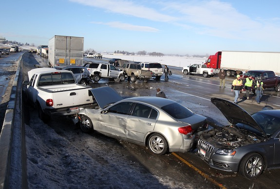 Vehicles are damaged after a pileup involving a logging truck and more than 40 other vehicles in Meridian, Idaho, Thursday, Jan. 9, 2014. Idaho State Police spokeswoman Teresa Baker said the crash happened as emergency responders tried to clear a previous wreck on Interstate 84, one of the state's main east-west highways. She said a motorist in a black Subaru tried to move to the right lane and away from the previous crash but clipped a silver Subaru. A logging truck then hit the black car, causing a chain-reaction crash in the interstate's westbound lanes that included four other tractor trailers. Baker said 10 people have been transported by ambulance to area hospitals, including the driver of the black Subaru. The man sustained serious injuries, but they aren't considered lift-threatening, Baker said. (AP Photo/The Idaho Statesman, Joe Jaszewski)  LOCAL TV OUT (KTVB 7)