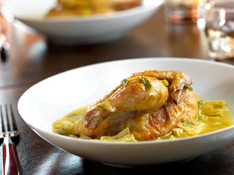 Champagne-Poached Cornish Game Hens with Artichokes, Potatoes, Spring Onions and Roasted Garlic