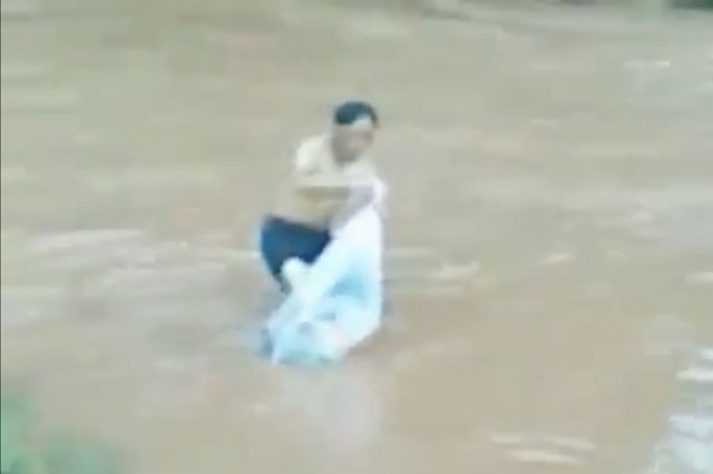 School run This man carries children across a flooded river in a plastic bag Vietnam video