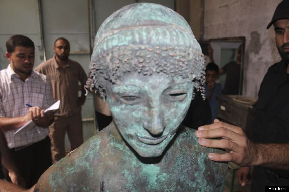 A bronze statue of the Greek God Apollo is pictured in Gaza in this September 19, 2013 picture provided by Gaza's Ministry of Tourism and Antiquities. Lost for centuries, the rare bronze statue of the Greek God Apollo has mysteriously resurfaced in the Gaza Strip, only to vanish almost immediately from view and be taken into police custody. A local fisherman says he scooped the 500-kg God from the sea bed last August, and carried it back home on a donkey cart, unaware of the significance of his catch. Picture taken September 19, 2013. To match Feature PALESTINIAN-APOLLO/GAZA REUTERS/Gaza's Ministry of Tourism and Antiquities/Handout via Reuters (GAZA - Tags: SOCIETY RELIGION)     ATTENTION EDITORS - THIS IMAGE WAS PROVIDED BY A THIRD PARTY. FOR EDITORIAL USE ONLY. NOT FOR SALE FOR MARKETING OR ADVERTISING CAMPAIGNS. THIS PICTURE IS DISTRIBUTED EXACTLY AS RECEIVED BY REUTERS, AS A SERVICE TO CLIENTS. NO SALES. NO ARCHIVES