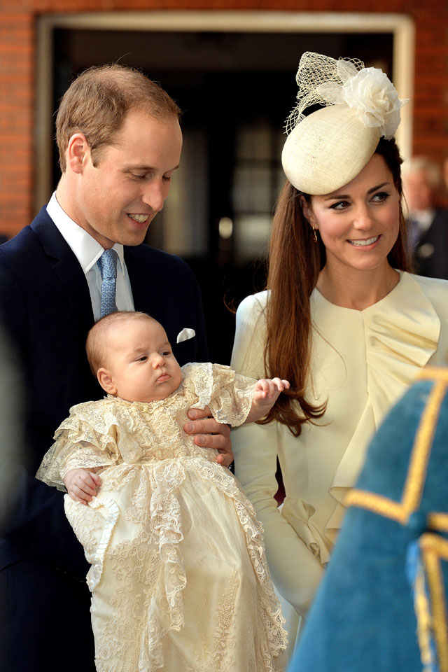 Britain's Prince William, Duke of Cambridge and his wife Catherine, Duchess of Cambridge, arrive with their son Prince George of Cambridge at Chapel Royal in St James's Palace in central London on October 23, 2013, ahead of the christening of the three month-old prince. Prince William and his wife Catherine gather close friends and family on Wednesday for the christening of their baby son Prince George, in a low-key ceremony far removed from the global hype surrounding their wedding. AFP PHOTO/POOL/JOHN STILLWELL        (Photo credit should read JOHN STILLWELL/AFP/Getty Images)